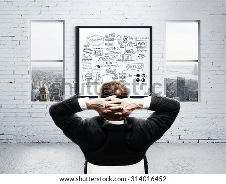 businessman in office and drawing graphs concept - stock photo