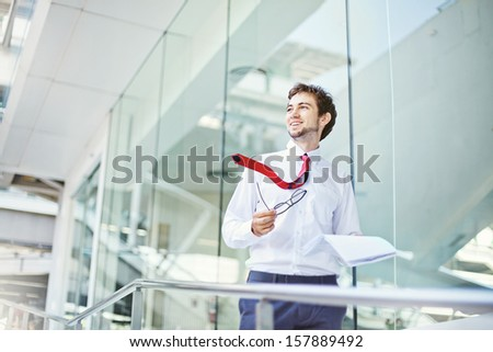 businessman in office center building  - stock photo