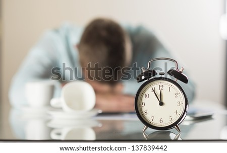 Businessman in office has problem with deadline - stock photo