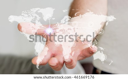 Businessman in office holding digital  world map with his hand