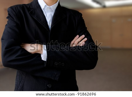 Businessman in office lobby background - stock photo