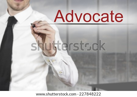 businessman in office room writing advocate in the air - stock photo