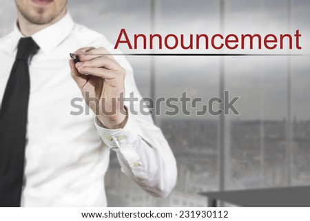 businessman in office writing announcement in the air - stock photo