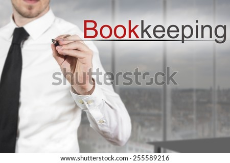 businessman in office writing bookkeeping in the air - stock photo