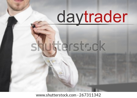 businessman in office writing daytrader in the air - stock photo