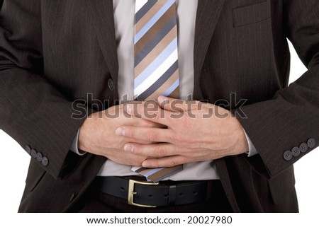 Businessman in pain holding his stomach isolated on white