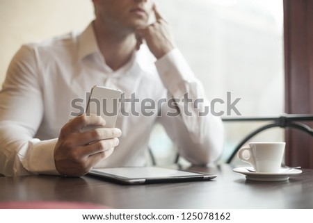 Businessman in restaurant - Beginning of working day - stock photo