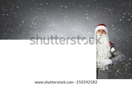 Businessman in santa hat with white blank banner
