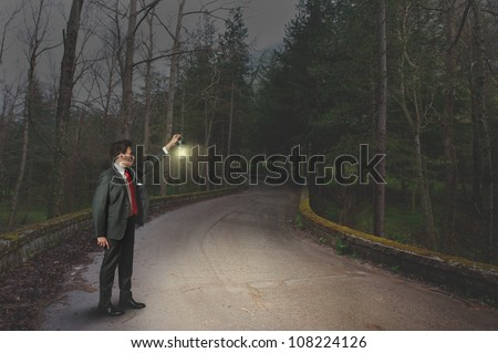 Businessman in search of new opportunities - stock photo