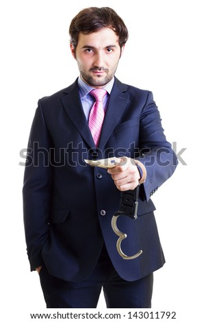 Businessman in shackles paid a bribe white background. Conceptual image. - stock photo