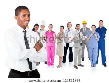 Businessman in shirt standing in front of different types of workers on white background - stock photo