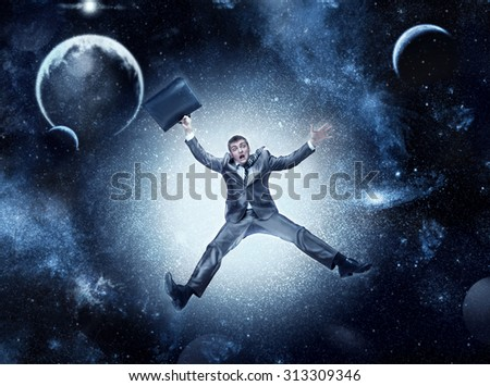 Businessman in space - stock photo