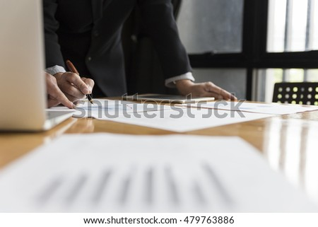 businessman in suit analyze with market analysis business chart document