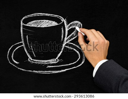 Businessman in suit drawing coffee cup on black blackboard background - coffee break symbol - stock photo