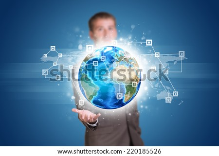 Businessman in suit hold Earth with world map and network. Elements of this image are furnished by NASA