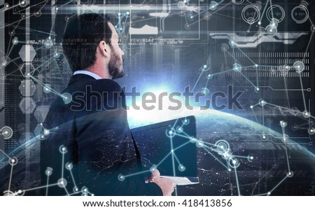Businessman in suit holding laptop against image of a earth - stock photo