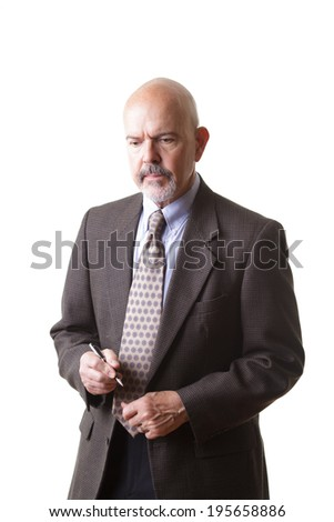 businessman in suit holding pen and thinking isolated on white background