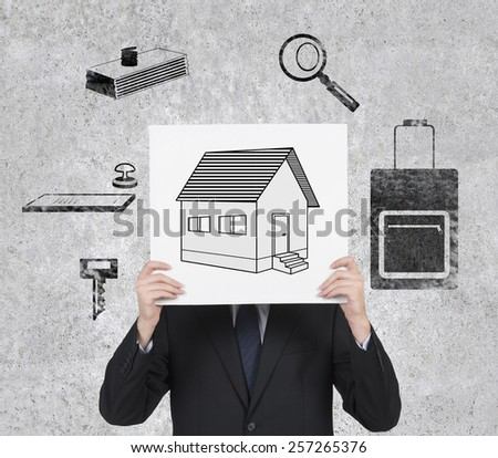 businessman in suit holding placard with real estate symbol - stock photo