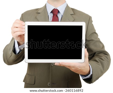 Businessman in suit holding up a tablet pc with blank screen for copy space - stock photo