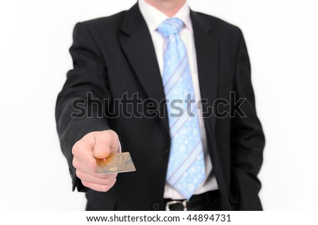 Businessman in suit holds a credit card in a hand. Isolated on the white background. - stock photo