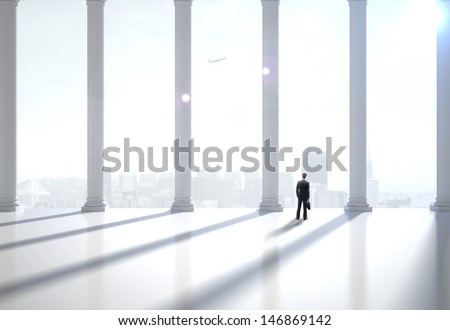 businessman in suit in the modern hall - stock photo