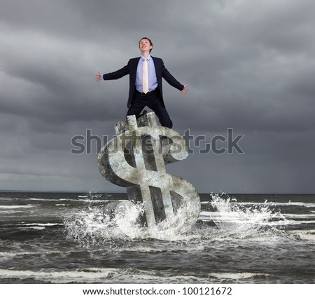 Businessman in suit praying for success in business - stock photo