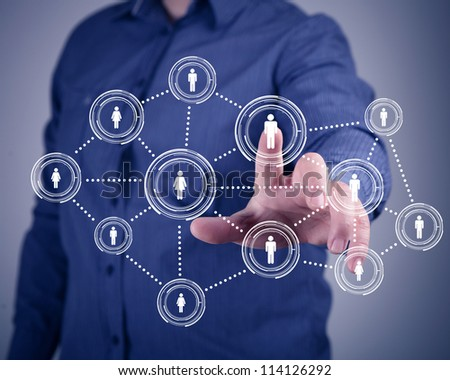 Businessman in suit pressing social media icon - stock photo
