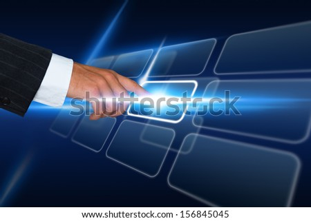 Businessman in suit pushing a button on a touch screen interface
