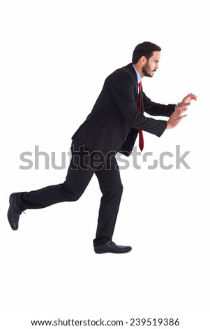 Businessman in suit pushing with hands on white background