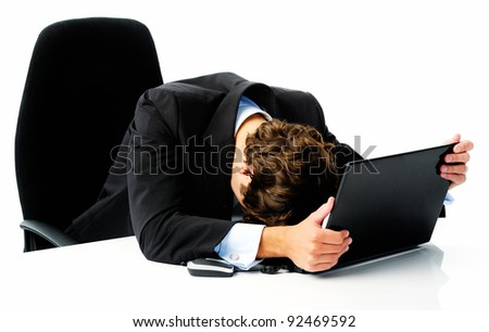 Businessman in suit puts his head down on his laptop computer when he fails to meet his target - stock photo