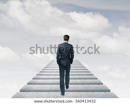 businessman in suit walking in the sky - stock photo