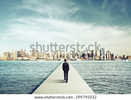 businessman in suit walking on concrete bridg to city