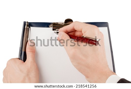 Businessman in suit writing on an empty paper in a clipboard isolated on white