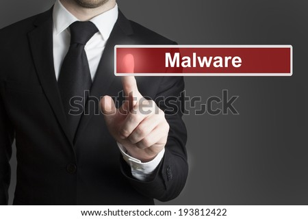 businessman in suite pressing touchscreen malware - stock photo