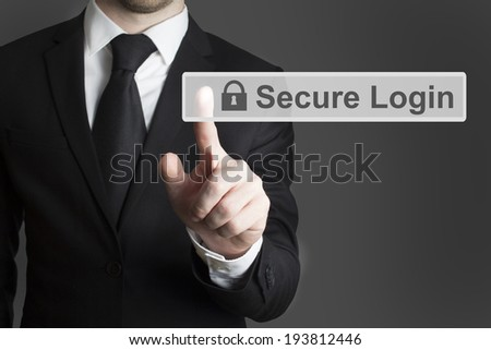 businessman in suite pressing touchscreen secure login - stock photo