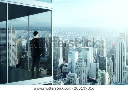 businessman in the modern office building - stock photo
