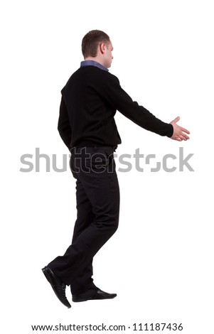 businessman in the movement reaches out to shake hands. Rear view people collection. backside view of person. Isolated over white background. - stock photo