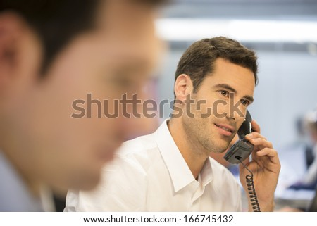 Businessman in the office on the phone  - stock photo