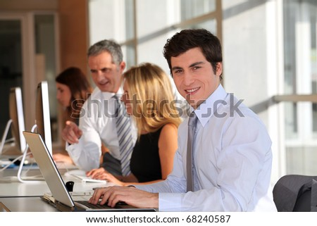 Businessman in the office with laptop computer