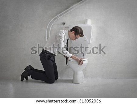 Businessman in the toilet - stock photo