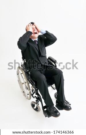 Businessman In Wheelchair - stock photo