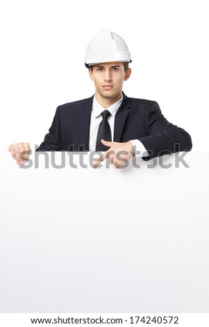 Businessman in white headpiece pointing hand gestures at copyspace, isolated on white. Concept of success and advertisement - stock photo