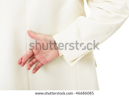 Businessman in white suit with crossed fingers behind his back