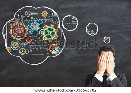 Businessman invents a business development plan - stock photo