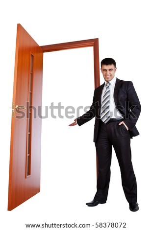 businessman invite you to opened door - stock photo