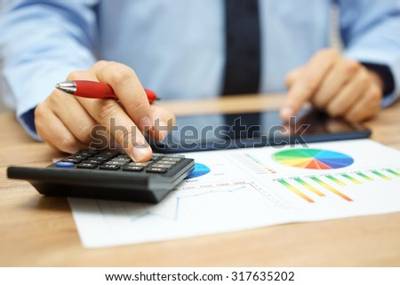 businessman is calculating his  business model - stock photo