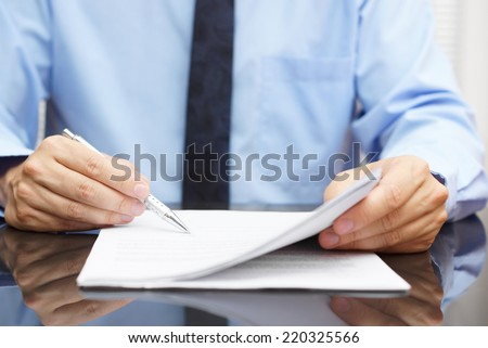 businessman is checking final price in contract - stock photo