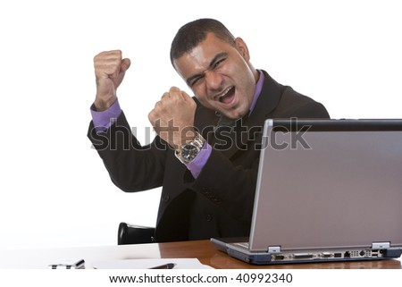 Businessman is cheering because he did the job well - stock photo