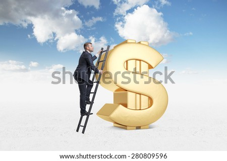 Businessman is climbing on the huge golden dollar sign. Blue sky with clouds background. - stock photo