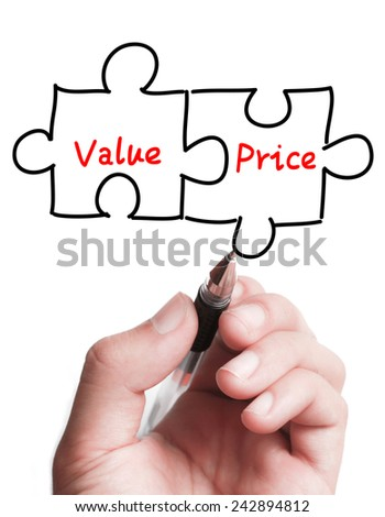 Businessman is drawing a Value and Price puzzle concept on the transparent virtual screen. - stock photo